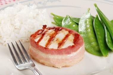 Bacon wrapped chicken with rice and snow