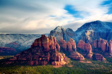 Scenic landscape with Red Rocks covered with snow. Sedona, Arizona. HDR image stock vector