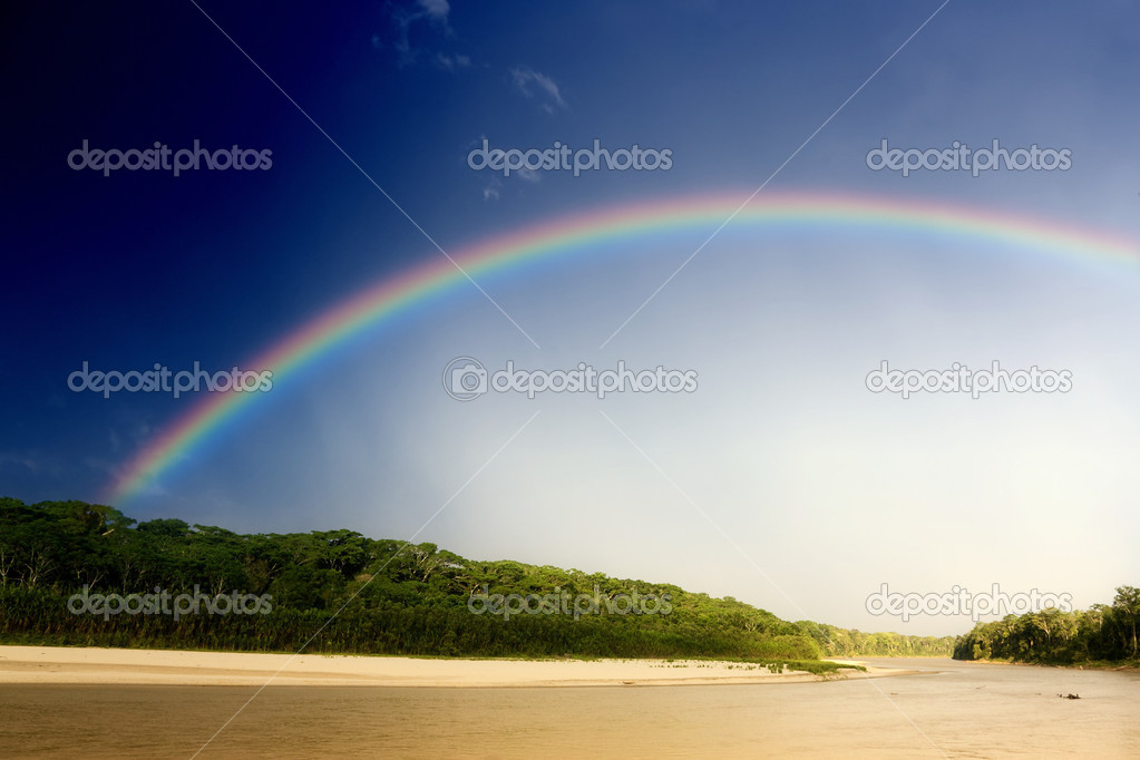 Rainbow over river