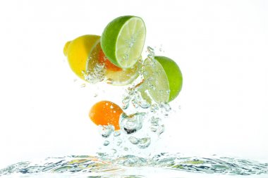 Citrus fruit jumping out of the water