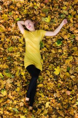 Beautiful woman - yellow autumn leaves