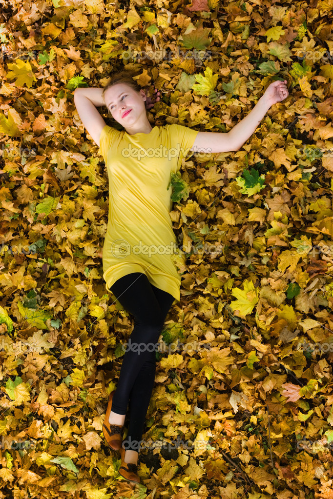 Beautiful woman - yellow autumn leaves