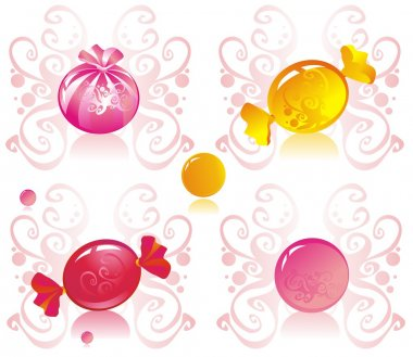 Colored candy on patterned background