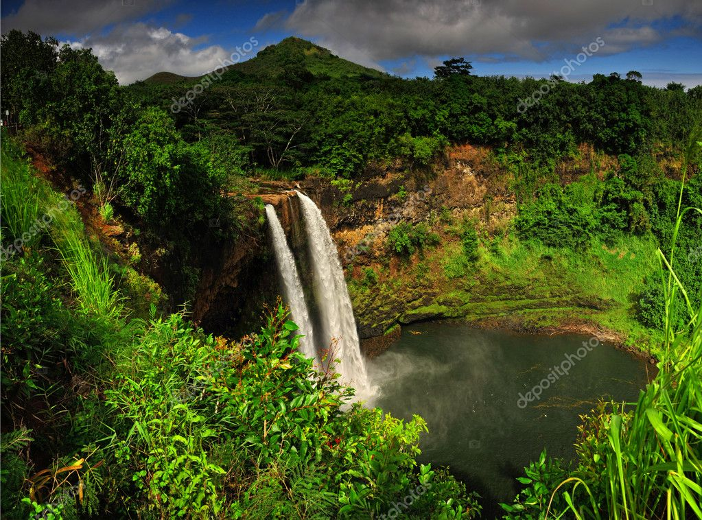 The Wailua falls tundering down into a quiet poo