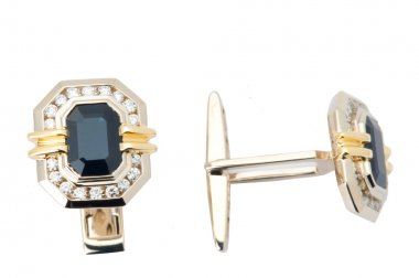 A pair of gold platinum cuff-links