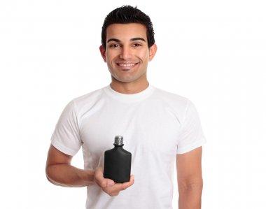Man holding black bottle or product