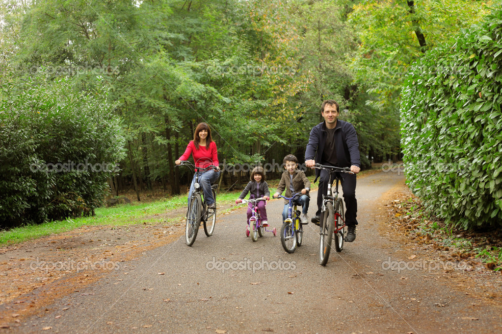 Happy family in bicycle
