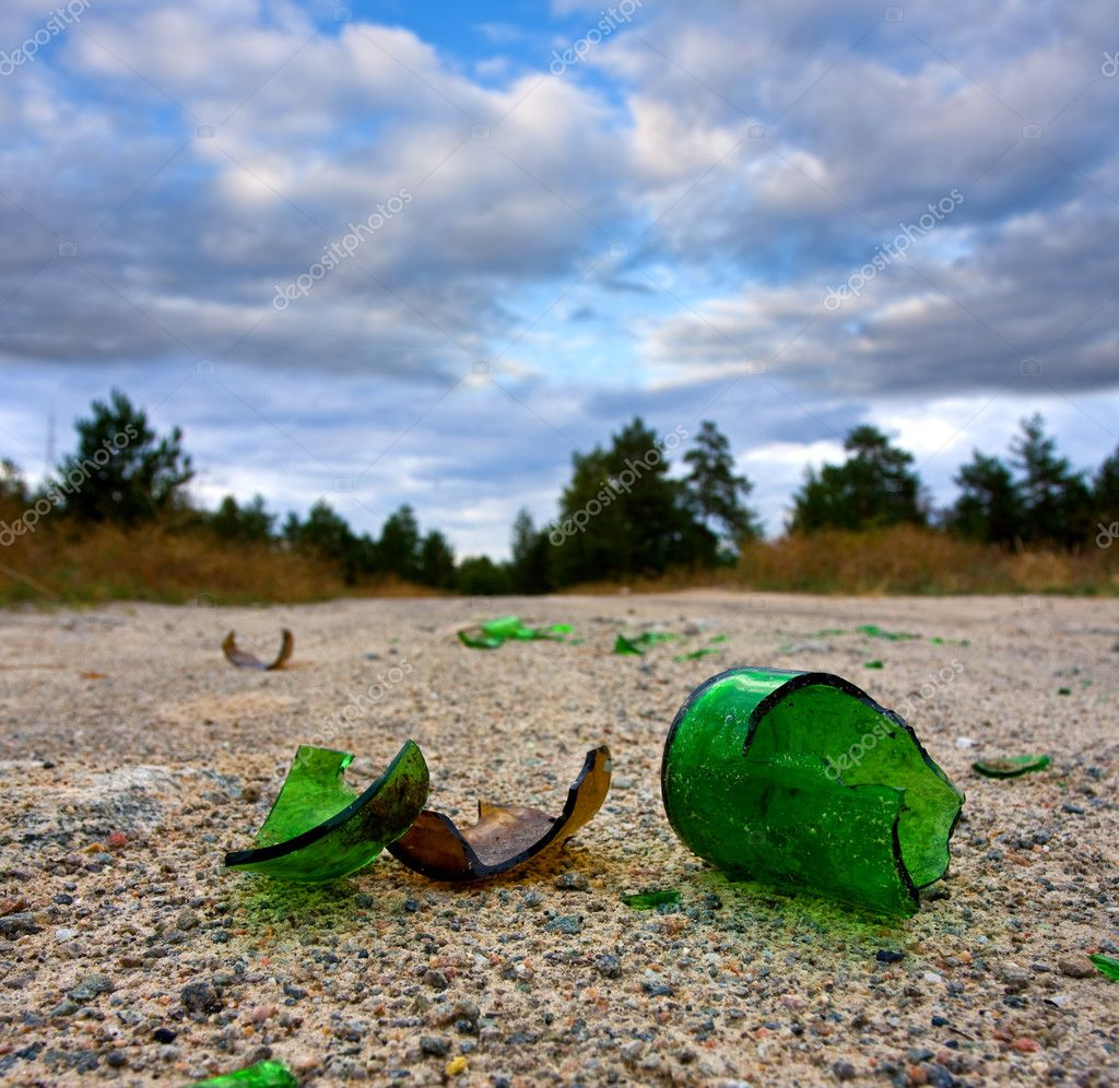 Broken glass bottle on road
