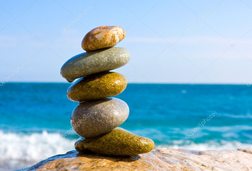 Balanced wet stones on sea