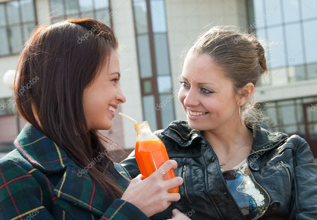 Photo Of Two Lesbians Use Modern Electronic Gadget Together, Enjoy Wireless Internet Connection