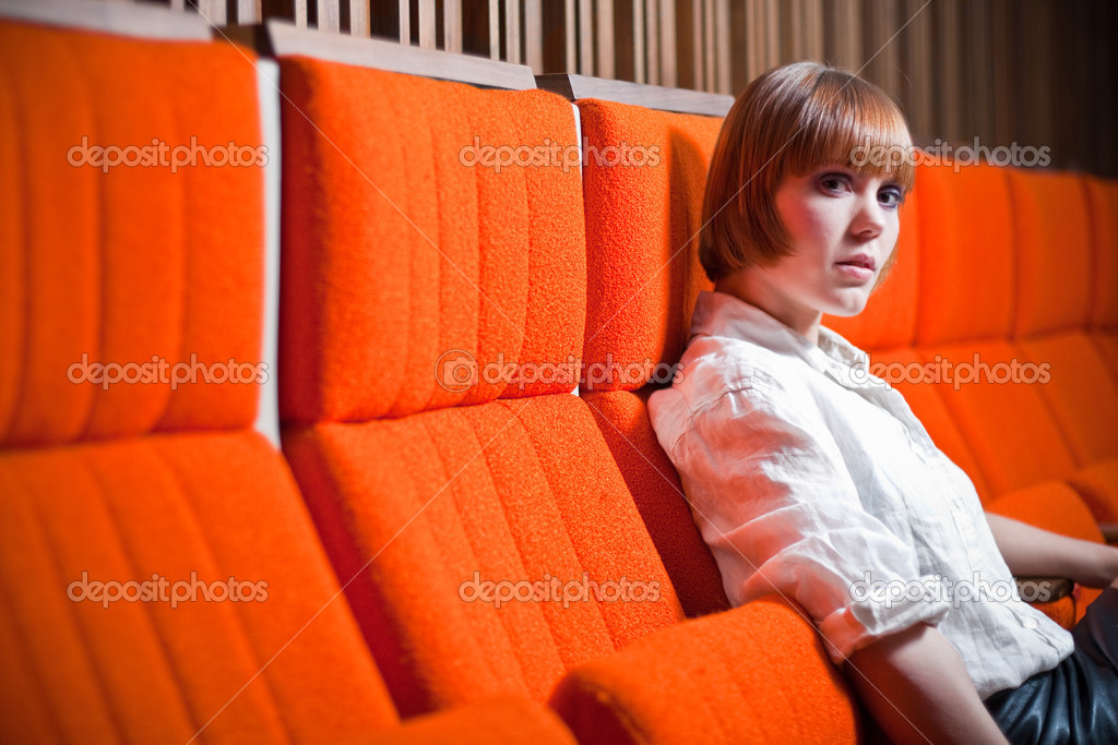 Woman in sitting in comfortable chair stock photo for Sitting easy chairs
