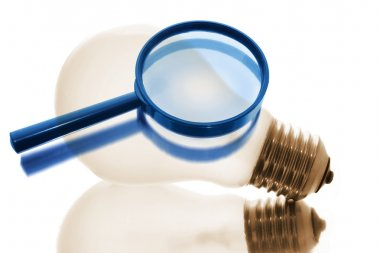 Magnifying Glass and Light Bulb