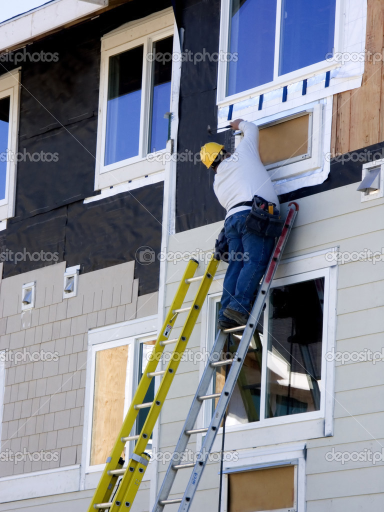 Man Hanging Siding - Construction