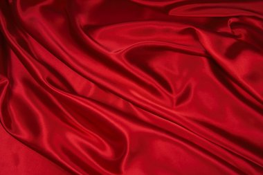 Luxurious deep red satin/silk folded fabric, useful for backgrounds stock vector