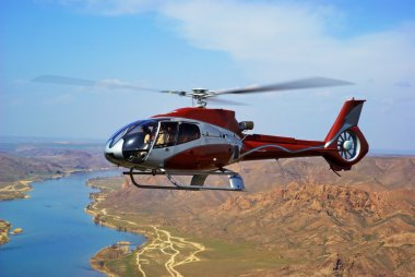 Helicopter on river in desert