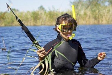 Underwater diving girl on lake