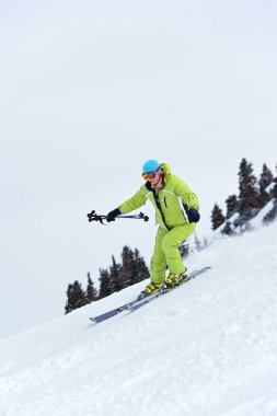 Ski woman turn on slope