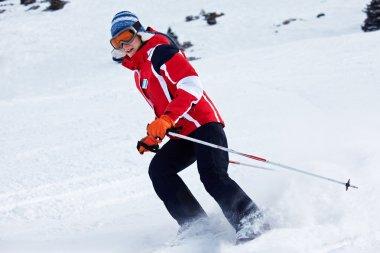 Ski woman turn on slope