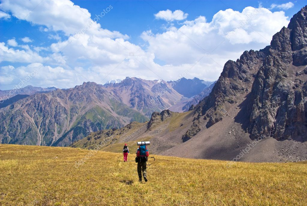 Two peoples Hiking in mountains