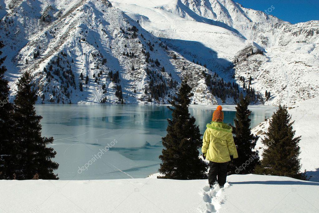 Small Girl by Mountain Lake
