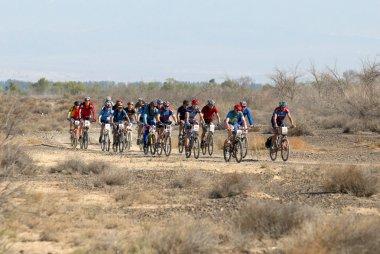 Mountain biker racing on desert road