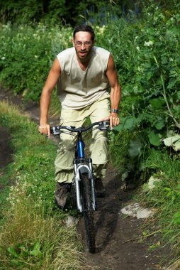 Mountain biker on old rural road