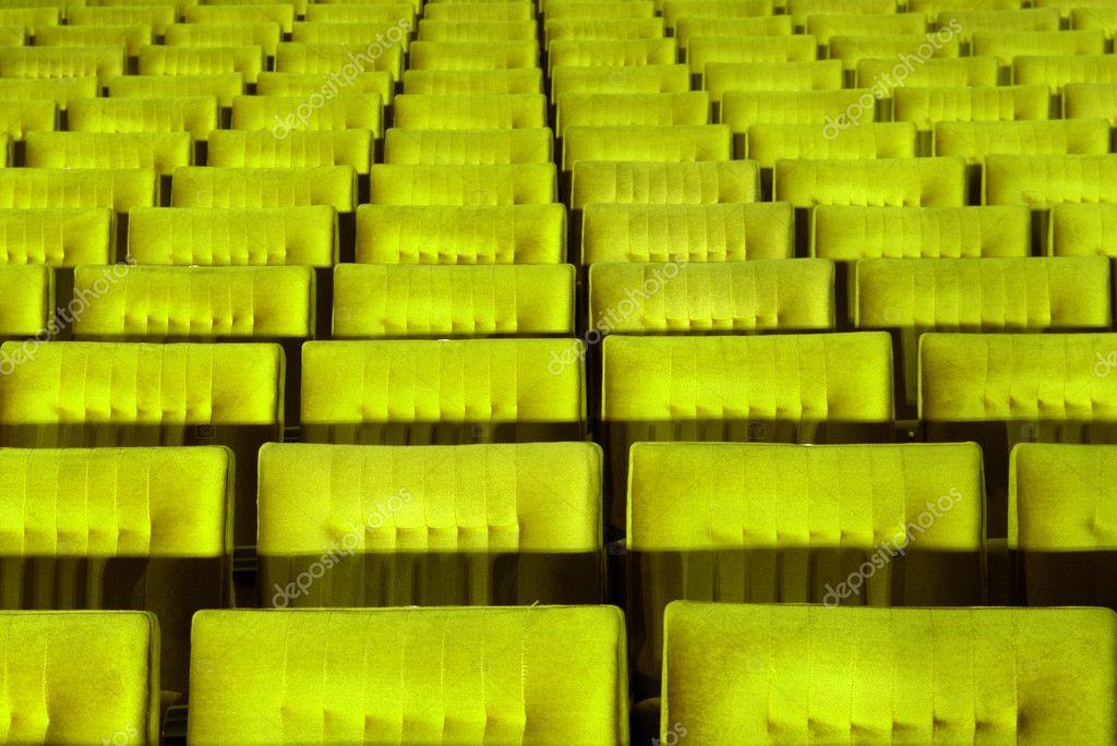 Yellow concert hall, opera or theatre seats. stock vector