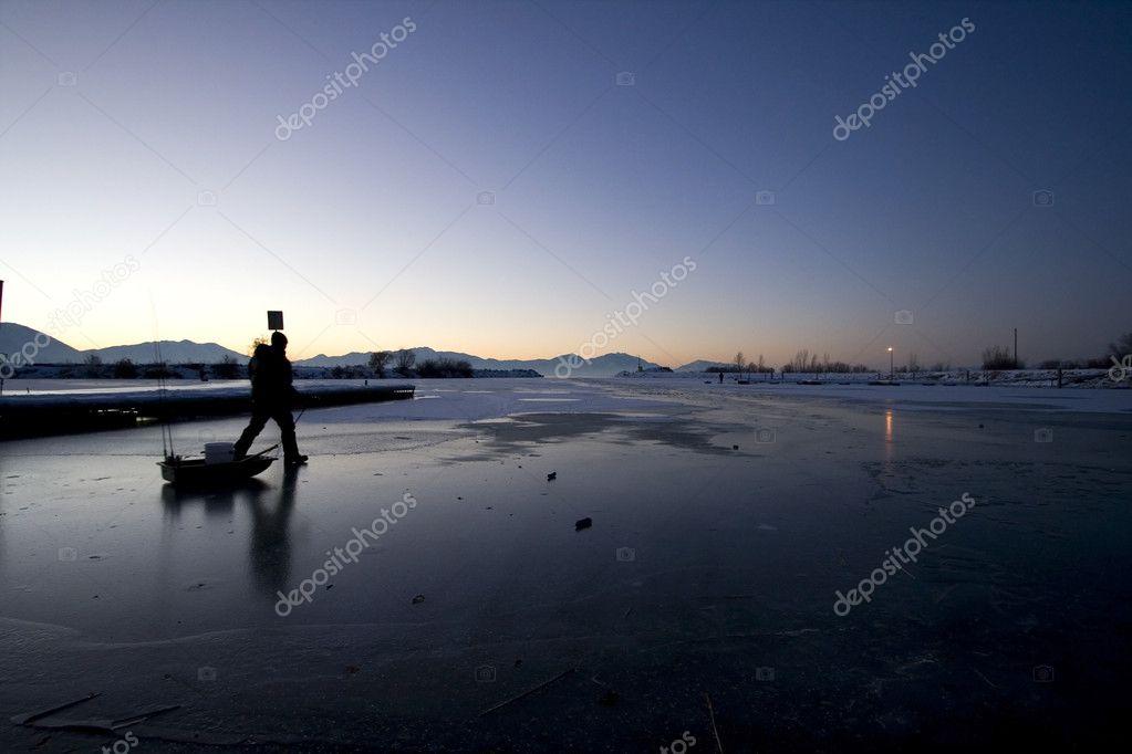 Fisherman Walking on Ice to Catch Fish