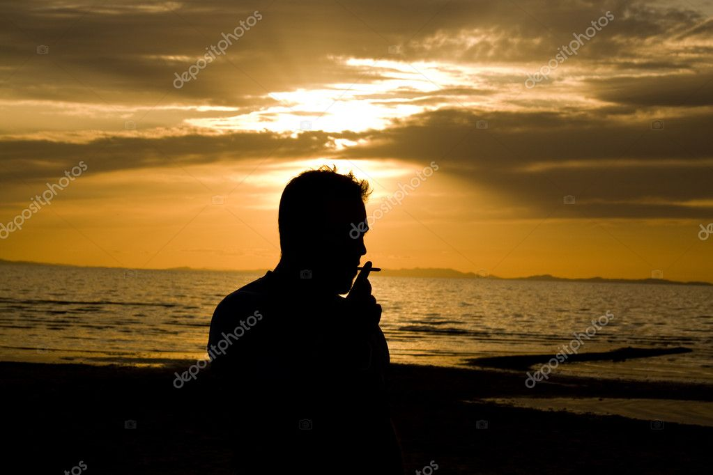 Man smoking by the Beach