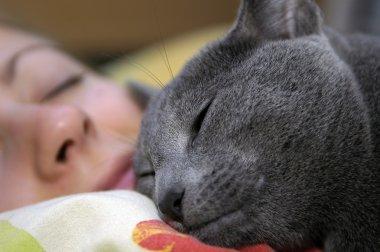 Cat and girl sleep