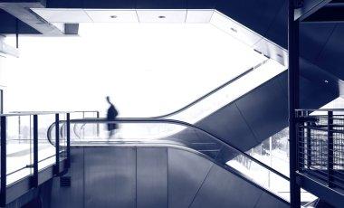 Business man move on escalator