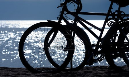 Photo for Silhouette of two bikes at the beach - Royalty Free Image