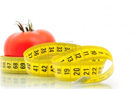 Photo for Tomato and measuring tape diet concept - Royalty Free Image
