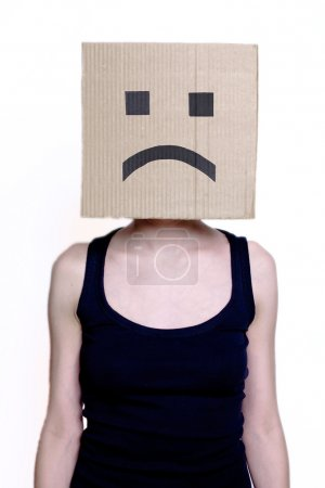 Photo for Girl in cardboard mask with sad smile - Royalty Free Image