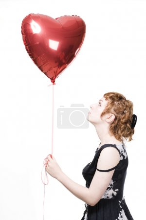 Girl with heart-shaped balloons