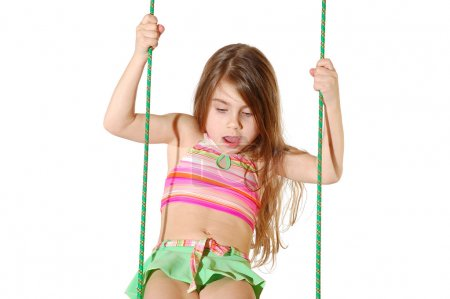 Photo for Portrait of a 5 year old girl swinging over white - Royalty Free Image