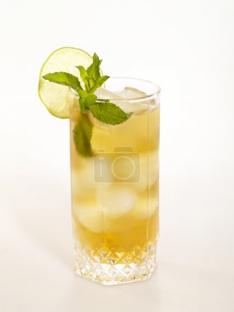 Cold fresh tea glass with lemon and mint
