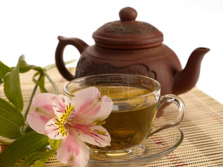 Tea ceremony. Green tea, flower and teap