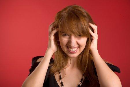 Angry girl with headache
