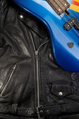 Close-up of a leather jacket with guitar