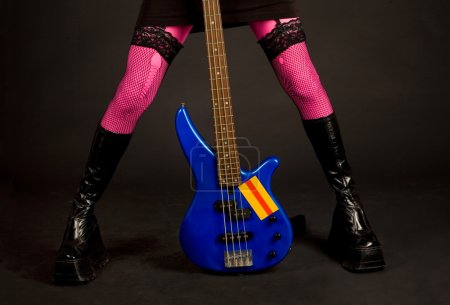 Close-up of woman legs with guitar