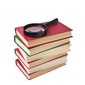 Stack of books and magnifying glass