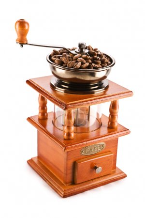 Old coffee mill isolated