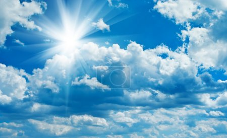 Photo for Blue cloudy sky with sun - Royalty Free Image