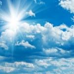 Blue cloudy sky with sun...