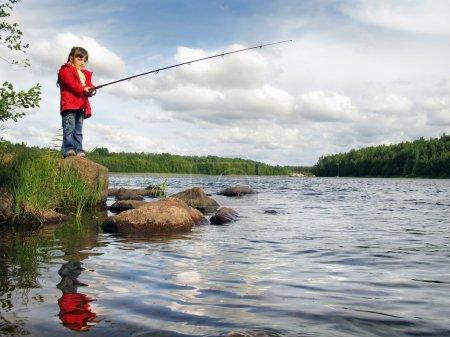Little angler on the lake