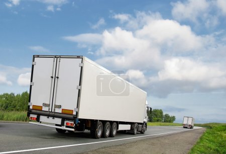White trucks on country highway