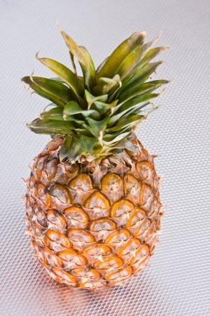 Pineapple on a grey surface