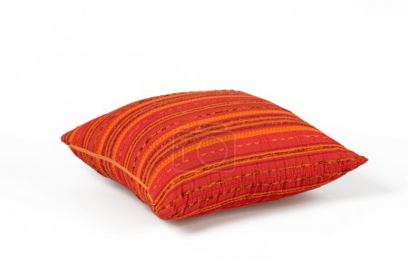 Red pillow on white
