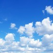 Blue sky background with a tiny clouds...